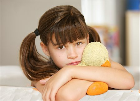 preteen girl pigtails - Girl Hugging a Stuffed Toy Duck Stock Photo - Rights-Managed, Code: 822-05948603
