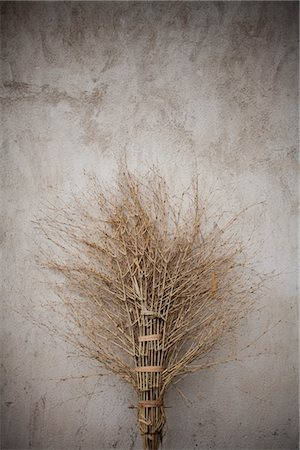 Rudimentary Bamboo Broom Leaning against Wall Stock Photo - Rights-Managed, Code: 822-05948612