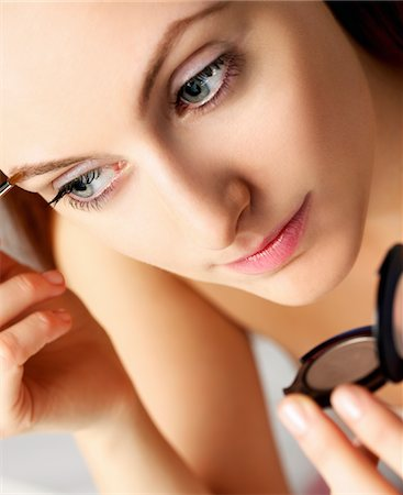 personal care - Woman Applying Makeup on Eyebrow Stock Photo - Rights-Managed, Code: 822-05948632