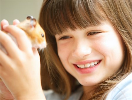 Smiling Girl Holding Hamster Stock Photo - Rights-Managed, Code: 822-05948696