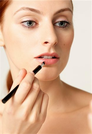 Woman Applying Lipstick with Brush Stock Photo - Rights-Managed, Code: 822-05948732