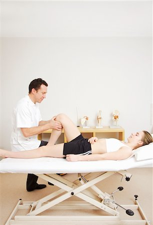 Osteopath Treating Female Patient Stock Photo - Rights-Managed, Code: 822-05948749