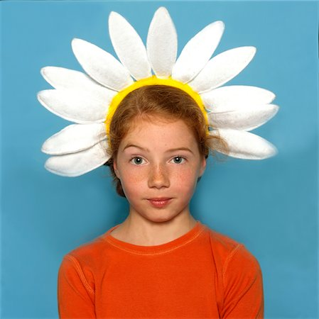 red hair preteen girl - Girl Wearing Daisy Headband Stock Photo - Rights-Managed, Code: 822-05948847