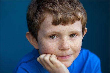 Portrait of Boy with Hand on Chin Stock Photo - Rights-Managed, Code: 822-05948857