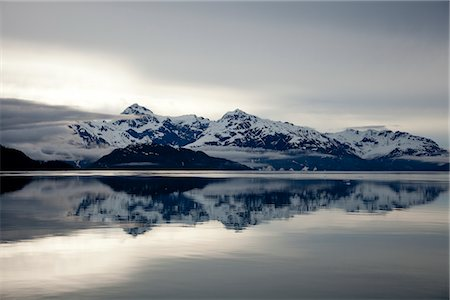 snow - Mountain Range Reflecting on Still Water of Glacier Bay, Alaska, USA Stock Photo - Rights-Managed, Code: 822-05948852