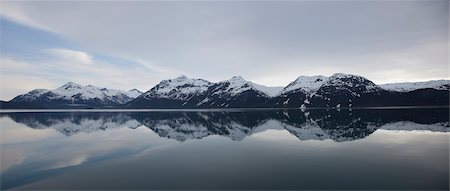 snow capped - Mountain Range Reflecting on Still Water of Glacier Bay, Alaska, USA Stock Photo - Rights-Managed, Code: 822-05948868