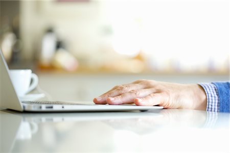 Close up of Man's Hand Using Laptop Stock Photo - Rights-Managed, Code: 822-05948870