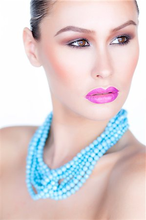 expensive jewelry - Woman Wearing Purple Lipstick and Turquoise Beads Necklace Stock Photo - Rights-Managed, Code: 822-06302344
