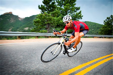 Cyclist Rounding a Bend Stock Photo - Rights-Managed, Code: 822-06302346