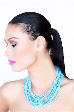 expensive jewelry - Woman Wearing Purple Lipstick and Turquoise Beads Necklace Stock Photo - Rights-Managed, Code: 822-06302340