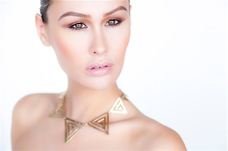 Portrait of Woman Wearing Gold Necklace Stock Photo - Rights-Managed, Code: 822-06302355