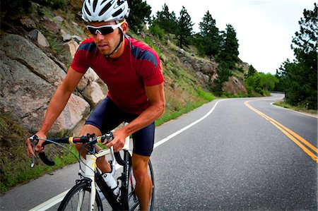 Cyclist Riding Bike on Road Stock Photo - Rights-Managed, Code: 822-06302352