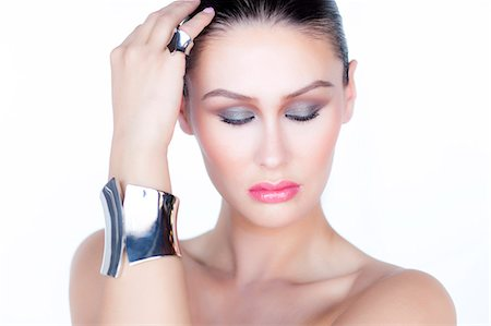 expensive jewelry - Portrait of Woman Wearing Silver Cuff Jewel Stock Photo - Rights-Managed, Code: 822-06302369