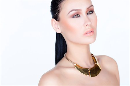 expensive jewelry - Portrait of Woman Wearing Gold Necklace Stock Photo - Rights-Managed, Code: 822-06302363