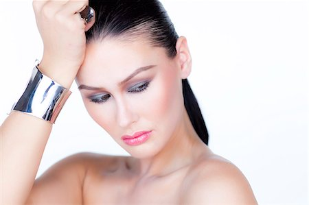 expensive jewelry - Portrait of Woman Wearing Silver Cuff Jewel Stock Photo - Rights-Managed, Code: 822-06302375
