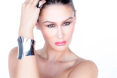 expensive jewelry - Portrait of Woman Wearing Silver Cuff Jewel Stock Photo - Rights-Managed, Code: 822-06302370