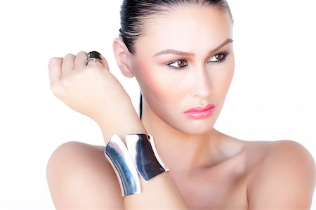 expensive jewelry - Portrait of Woman Wearing Silver Cuff Jewel Stock Photo - Rights-Managed, Code: 822-06302372
