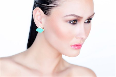 expensive jewelry - Portrait of Woman Wearing Gold Enamel Earring Stock Photo - Rights-Managed, Code: 822-06302380