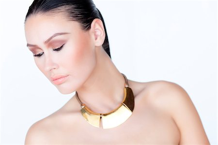 expensive jewelry - Portrait of Woman Wearing Gold Necklace Stock Photo - Rights-Managed, Code: 822-06302381