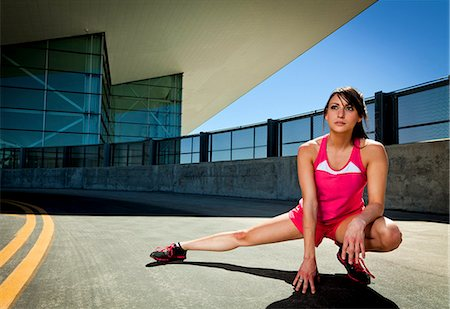 stretching (people exercising) - Young Woman Stretching Outdoors Stock Photo - Rights-Managed, Code: 822-06302417