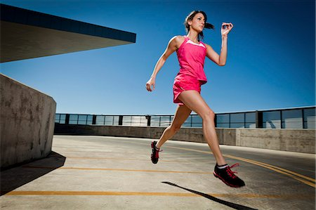Young Woman Running Outdoors Stock Photo - Rights-Managed, Code: 822-06302418