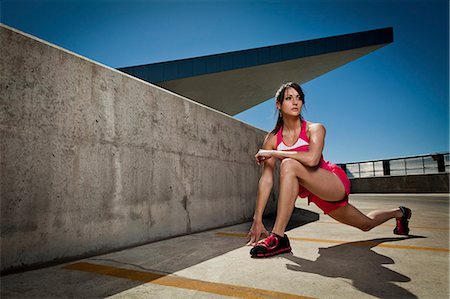 Young Woman Stretching Outdoors Stock Photo - Rights-Managed, Code: 822-06302411