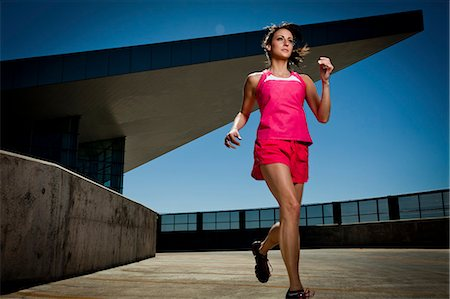 Young Woman Running Outdoors Stock Photo - Rights-Managed, Code: 822-06302427