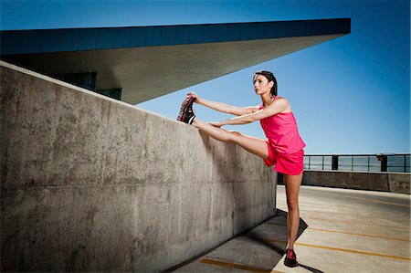 Young Woman Stretching Outdoors Stock Photo - Rights-Managed, Code: 822-06302448