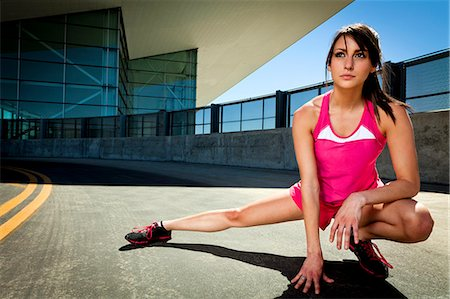 Young Woman Stretching Outdoors Stock Photo - Rights-Managed, Code: 822-06302458