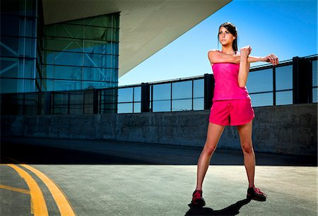 Young Woman Stretching Outdoors Stock Photo - Rights-Managed, Code: 822-06302473