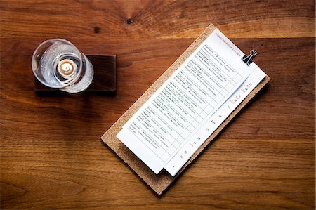 dece11 - Menu and Candleholder on Wooden Table Stock Photo - Rights-Managed, Code: 822-06302482