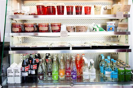 fridge - Shop Refrigerator Shelves Stacked with Food Containers and Soft Drink Bottles Stock Photo - Rights-Managed, Code: 822-06302515