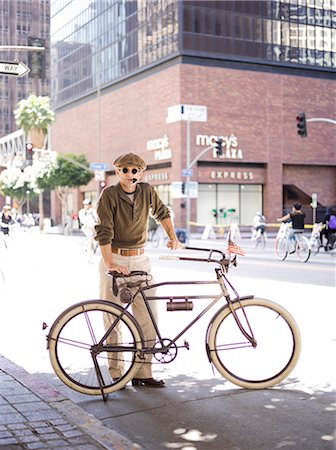 Man with Bicycle Smoking Pipe Stock Photo - Rights-Managed, Code: 822-06302525