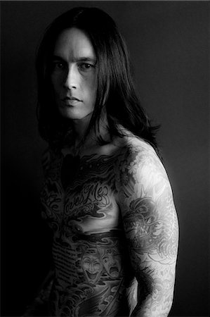 Portrait of Man Covered in Tattoos Stock Photo - Rights-Managed, Code: 822-06302520