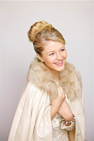fur - Smiling Woman in Fur Trim Coat Stock Photo - Rights-Managed, Code: 822-06302568