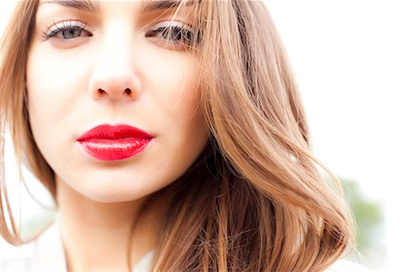 Close up of Young Woman Wearing Red Lipstick Stock Photo - Rights-Managed, Code: 822-06302562