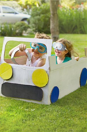 Boy and Girl Wearing Goggles Driving Cardboard Car Stock Photo - Rights-Managed, Code: 822-06302573