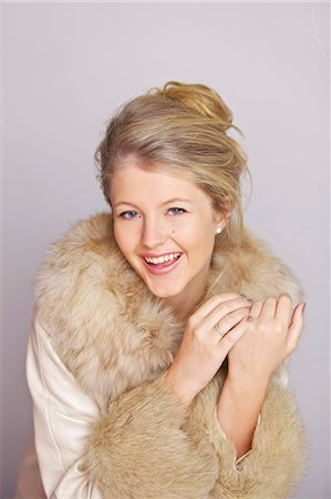 fur - Smiling Woman in Fur Trim Coat Stock Photo - Rights-Managed, Code: 822-06302617