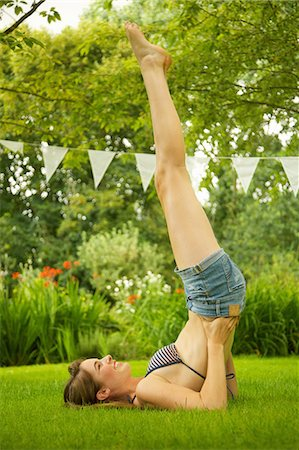 Teenage Girl Doing Shoulder Stand in Garden Stock Photo - Rights-Managed, Code: 822-06302625