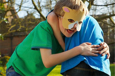 preteen boys playing - Boy Wearing Cat Mask Fighting with Friend Stock Photo - Rights-Managed, Code: 822-06302644