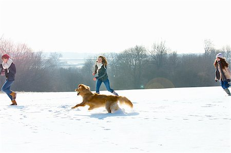 Teenage Girls and Dog Running in Snow Stock Photo - Rights-Managed, Code: 822-06302646
