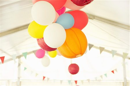 Paper Lanterns and Party Balloons Floating Inside a Marquee Stock Photo - Rights-Managed, Code: 822-06302655