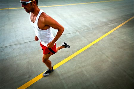 runner (male) - Man Running on Urban Road Stock Photo - Rights-Managed, Code: 822-06302657