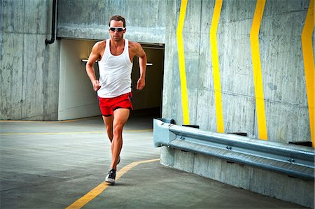 runner (male) - Man Running on Urban Road Stock Photo - Rights-Managed, Code: 822-06302658
