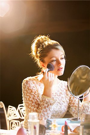 personal care - Young Woman Applying Blush Stock Photo - Rights-Managed, Code: 822-06302664