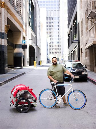 Man with Bicycle and Trailer Stock Photo - Rights-Managed, Code: 822-06302666