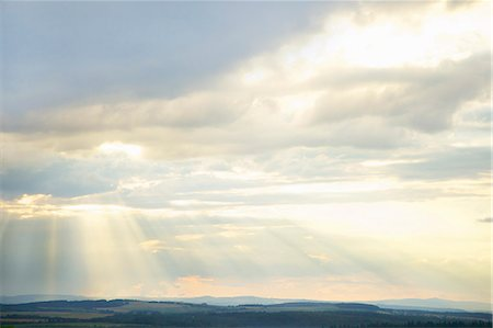 sky - Sunbeams through Clouds over Rural Landscape Stock Photo - Rights-Managed, Code: 822-06302686
