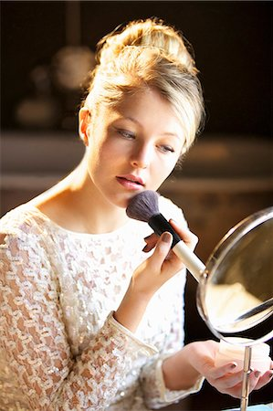personal care - Young Woman Applying Blush Stock Photo - Rights-Managed, Code: 822-06302700