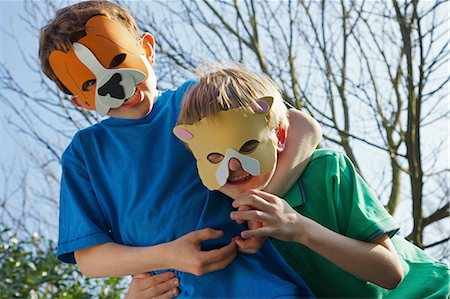 preteen boys playing - Two Boys Wearing Animal Masks Messing Around Stock Photo - Rights-Managed, Code: 822-06302717