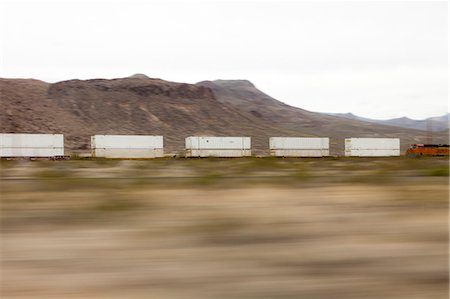 Mountain Landscape and Freight Train, Blurred Motion Stock Photo - Rights-Managed, Code: 822-06302718